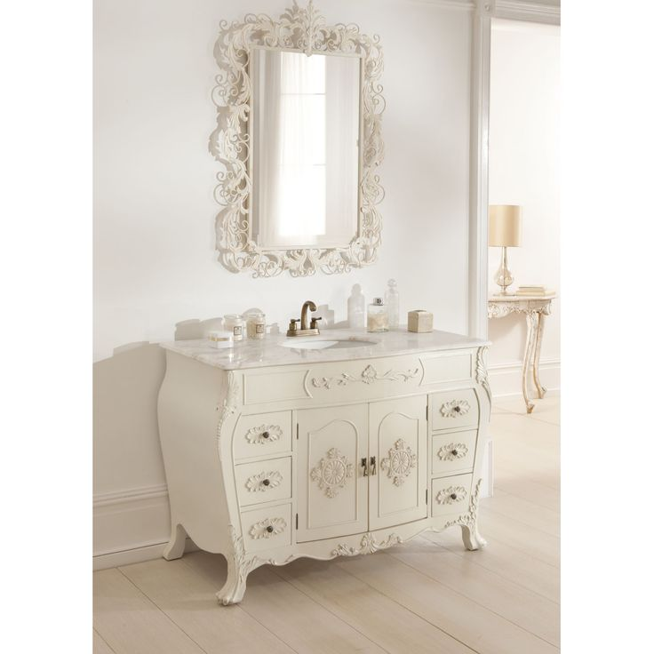 This Shabby Chic Sink With An Ornate Mirror Above Creates Elegant