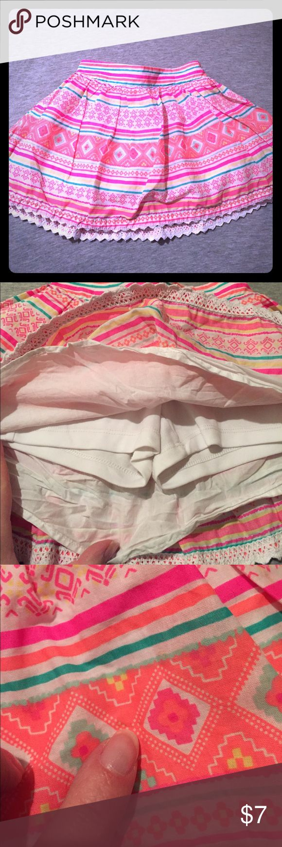 Tribal print skort Perfect for summer. Bright colors. Very faint tiny mark that isn't noticeable unless at close look. Skort is great for active little girls no need to worry about panties showing! Sonoma Bottoms Skorts