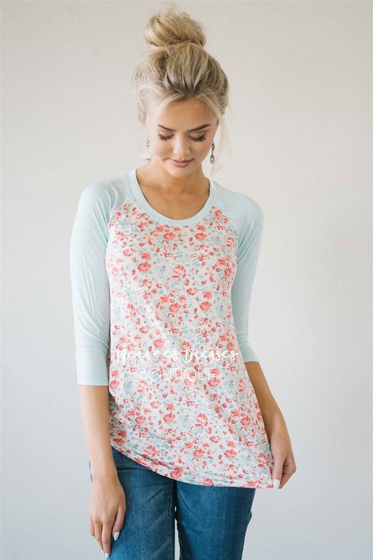 It doesn't get any cuter than this top, it is absolutely perfect for casual days. Mint and coral mini floral top has mint baseball style sleeves.
