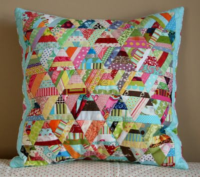 scrappy triangles cushion cover - linked to tutorial for making the triangles