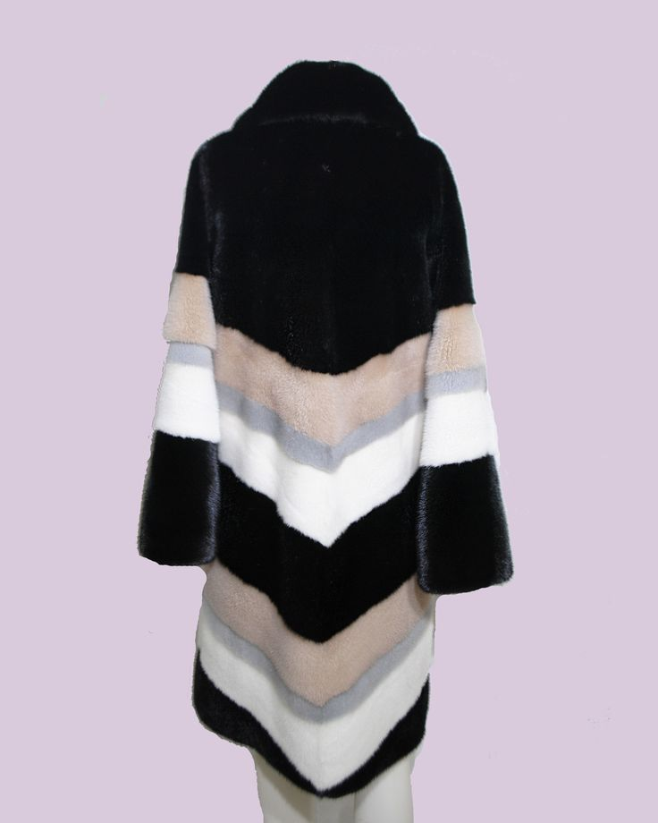 """Always fashionable, this multi colour mink coat is definitely a """"must""""."""