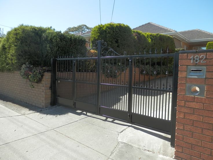 Bi-Fold Trackless Automatic Gates with Rising Hinges - With no space for a sliding gate and drive too steep for a swing gate. http://www.themotorisedgatecompany.com.au/recent-work