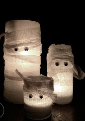 Light up Halloween night with these Charmingly Cute Mummy Candles. This is a super fast and easy Halloween craft for kids. Find a few mason jars around the house to make this homemade Halloween decoration. Don't forget the googly eyes!