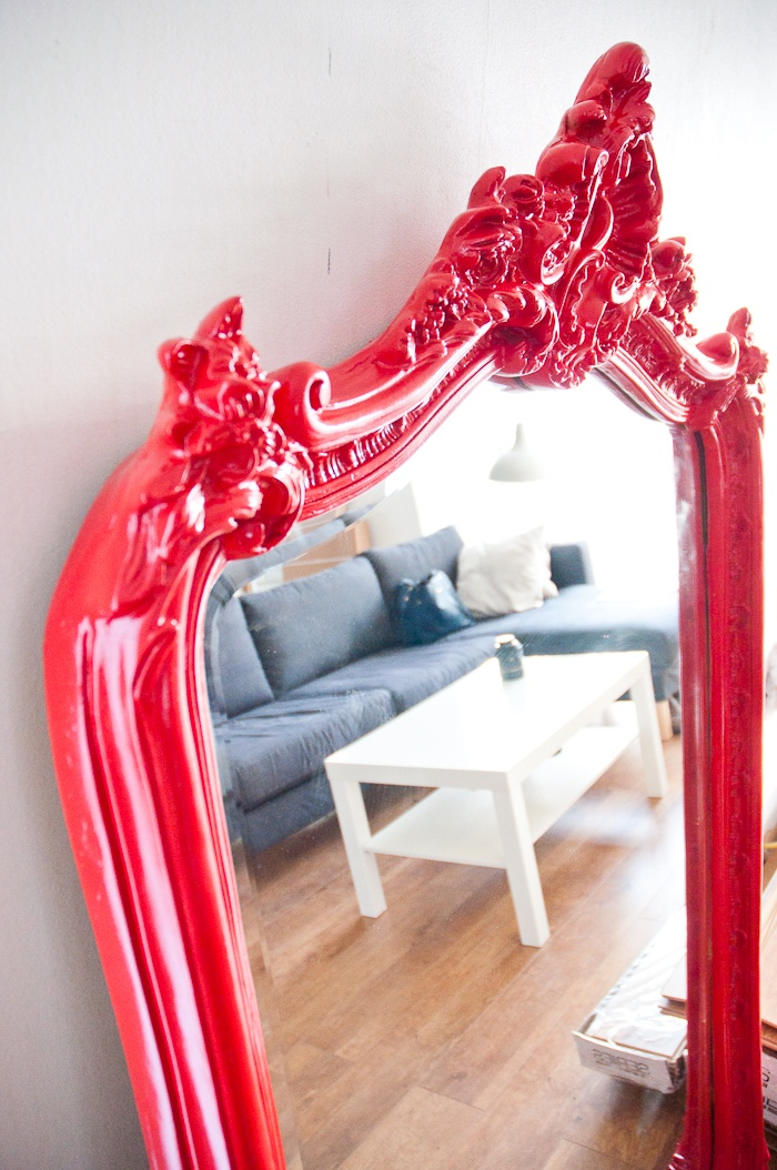 A glossy red spray painted mirror with an ornate frame - how to step by step