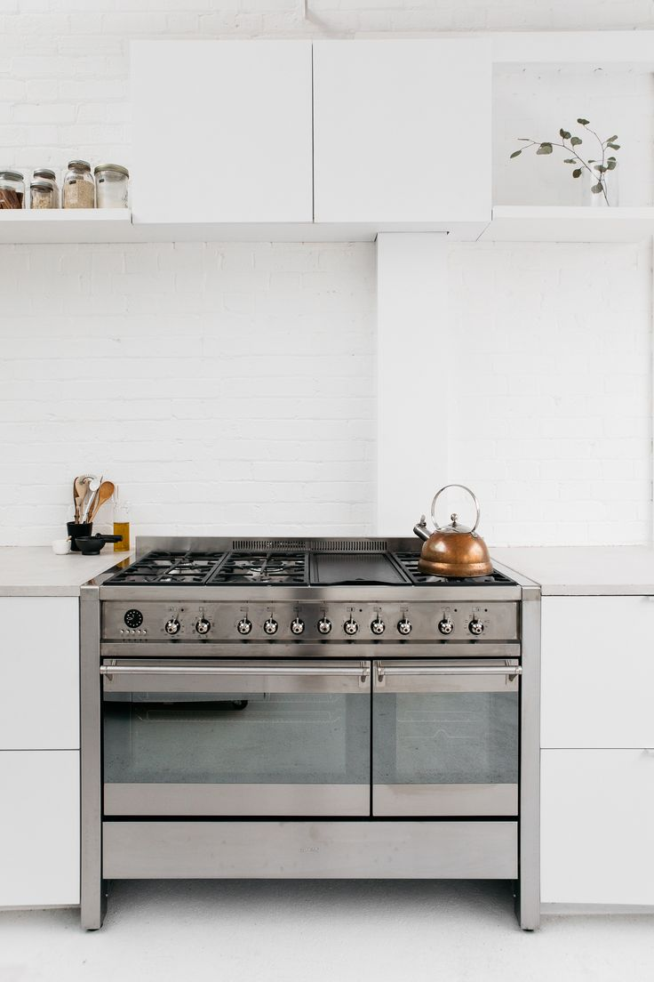 Smeg stainless steel two-door range and copper tea kettle in the Rye London kitchen