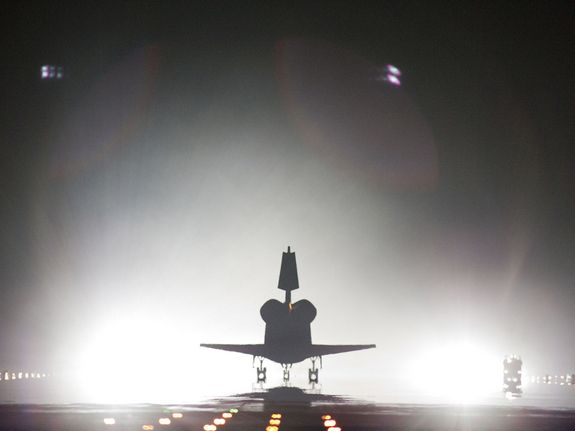Xenon lights help lead space shuttle Endeavour home to NASA's Kennedy Space Center in Florida. Endeavour landed for the final time on the Shuttle Landing Facility's Runway 15, marking the 24th night landing of NASA's Space Shuttle Program.    On board are STS-134 Commander Mark Kelly, Pilot Greg H. Johnson, and Mission Specialists Mike Fincke, Drew Feustel, Greg Chamitoff and the European Space Agency's Roberto Vittori. STS-134 delivered the Alpha Magnetic Spectrometer-2 (AMS) and the…