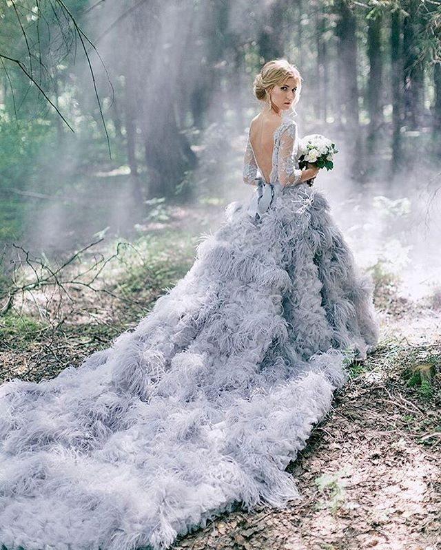 Kate'S has done it again with this out-of-this-world feathered gown! We can't…
