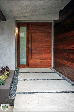 Get a modern stained wood entry way for your home. A simple upgrade to your exterior door can go a long way to upgrading your entire home.