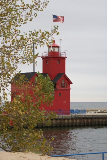 """Big Red lighthouse is a very unique lighthouse. It is set apart from other lighthouses by it's bright """"fire engine"""" red color and it's distinctive Dutch archictecture. I was delighted to see this unusual lighthouse on my visit to Holland, Michigan."""