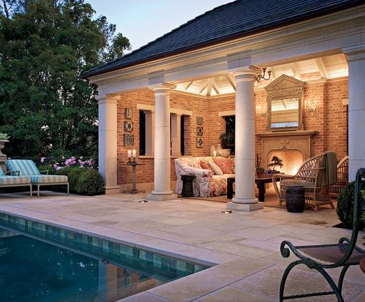 This pretty brick walled columned covered porch is intimate and inviting with a pretty limestone - Houses large patios ...
