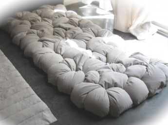 'Twist' DIY mattress {cotton tubes that you fill with whatever, tieing off sections as you fill, then twist together to form a bed} ;; WOULD GE GREAT ON A FUTONish FRAME