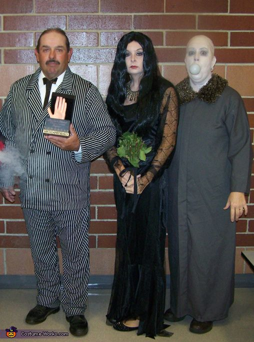 Lesli: We're creepy and we're kooky . . . two lunch ladies and one custodian from the local elementary school dressed up on Halloween as Addams Family members. Morticia's dress and...