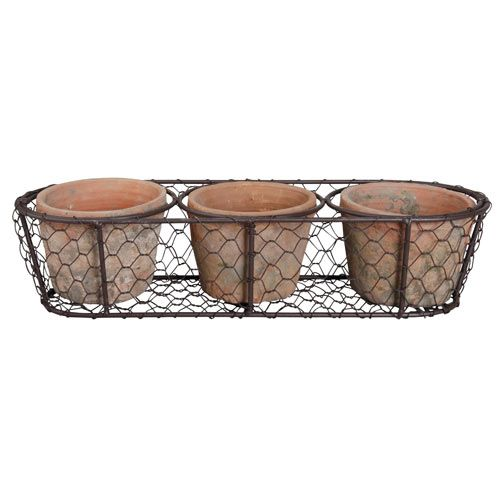 This trio of terracotta pots is perfect for displaying plants on a windowsill, or outside in the summer. Fill the pots with herbs for use in the kitchen or plant with other pretty seasonal flowers.   http://www.english-heritageshop.org.uk/garden/plant-gifts/3-aged-terracotta-pots-in-a-wire-basket