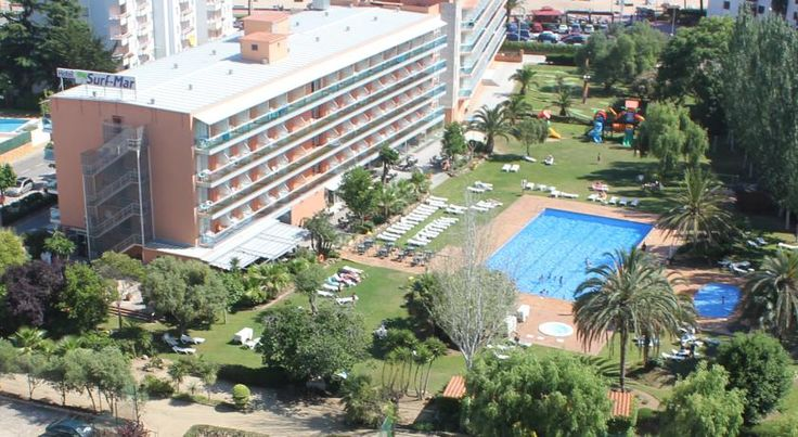 Hotel Surf Mar Lloret De Mar Surf Mar Hotel is on Fenals Beach, a quiet area 1 km from lively Lloret. This modern hotel has an outdoor pool with a hot tub, tennis courts and mini golf.