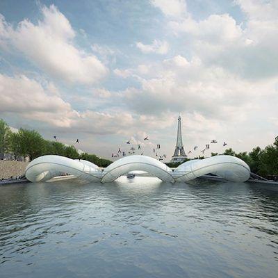 """Il Pont Trampoline, progettato dall'archiettetto francese Grgoire Zndel dellostudio di architettura AZC, Atelier Zundel Cristea, per il concorso """"Un Pont à Paris"""", è un ponte gonfiabile con al centro dei tappeti elastici che permettono di attraversare la Senna saltando da una sponda all'altra. Il ponte è stato installato nei pressi della Tour Eiffel. Viarepubblica.it"""