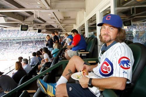 Eddie Vedder enjoying a hot dog at a Chicago Cubs game. #PearlJam