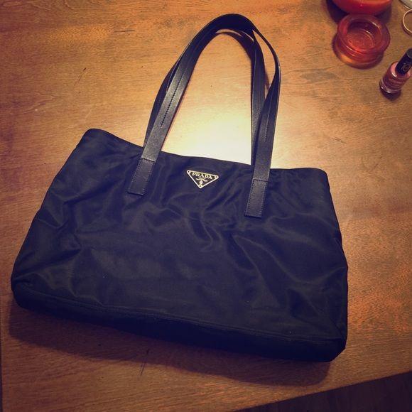 Prada handbag! Black Prada purse! Super cute and classic. Used but in perfect condition. No damage. Prada Bags Shoulder Bags