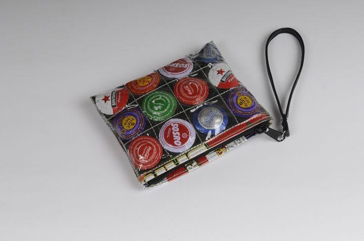 Small zip clutch using bottle-caps