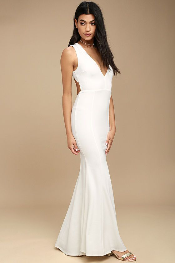 You'll be a divine display in the Heaven and Earth White Maxi Dress! Medium-weight stretch knit forms a sleeveless bodice, with plunging V-neck, darting, and wide straps that cross atop an open back. Bit of elastic at the waist tops the figure-flaunting maxi skirt. Hidden back zipper/clasp.