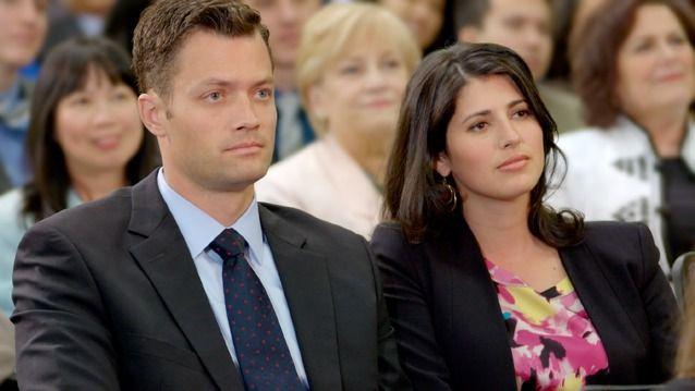 Um casal numa reunião das Testemunhas de Jeová