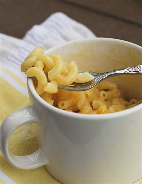 QUIT buying easy mac, people!  Instant Mug o' Mac & Cheese in the Microwave: 1/3 cup pasta, 1/2 cup water, 1/4 cup 1% milk, 1/2 cup shredded cheddar cheese. Perfect for Addy!