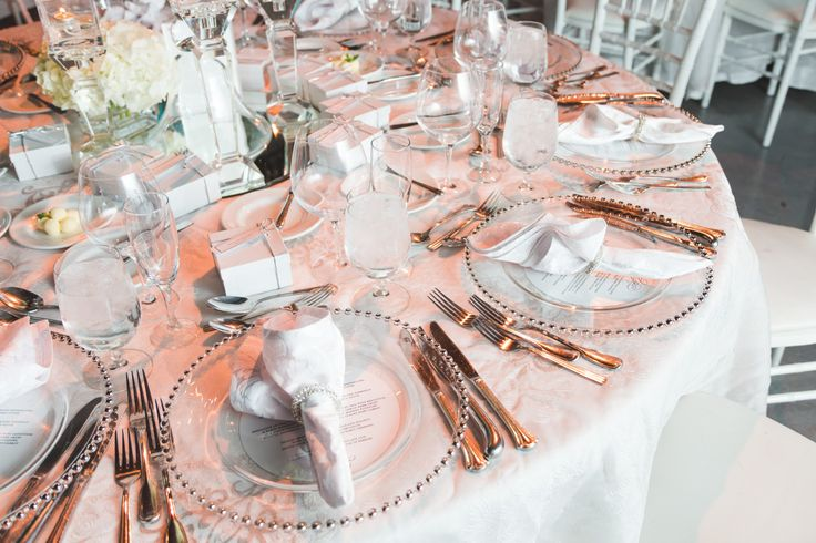 Elegant plate setting - Gold beaded clear glass charger plate, silver trinity napkin ring, and a French lace overlay on the table. http://www.fusion-events.ca/