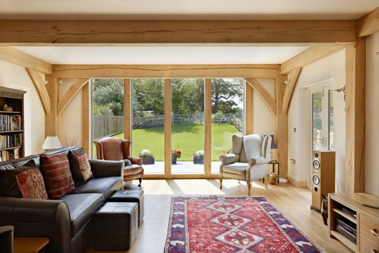 Floor to ceiling windows in this sitting room opens the space outwards to the garden.
