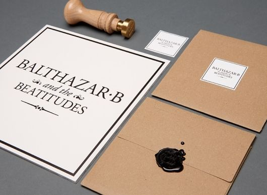 Sealing invitations with a custom wax stamp - could be sweet!