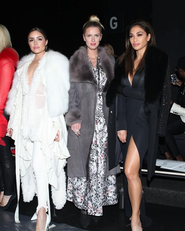Nicky Hilton and Nicole Scherzinger sit front row at the Thomas Wylde show during New York Fashion Week on Feb. 15, 2016.