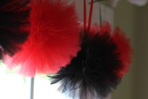 Tulle pom poms DIY- instead of tissue paper? Not too much of a price difference and I think the tulle looks way better!!