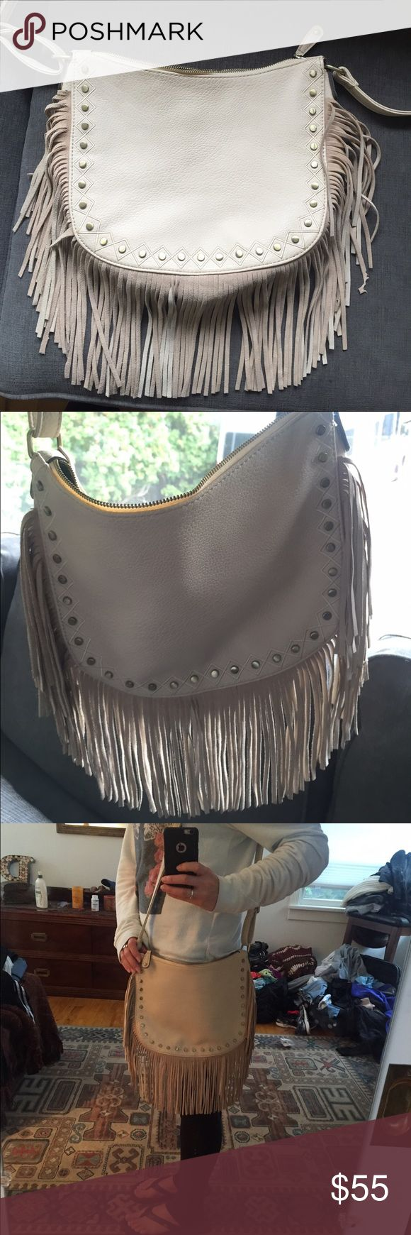 Gabriella Rocha Briley Studded Fringe Purse I only used this purse 2 times so it's like new. I bought it for $90 on 6pm.com last year if I remember right, just found it in storage at my moms house and have too many new purses! The strap is adjustable, genuine leather. The fringe is very soft. Gabriella Rocha Bags Crossbody Bags