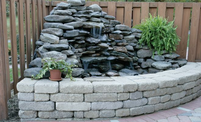 Corner fountain with retaining wall landscaping water for Square pond ideas