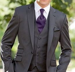 Dark Grey Suit and Deep Purple Tie. Tie could be a little skinnier.                                                                                                                                                                                 More