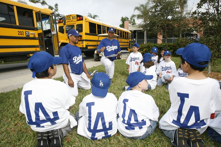 1B James Loney reads to a group of young Dodger fans