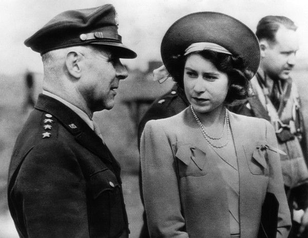 World War II. US Air Force General James Doolittle and future Queen of England Princess Elizabeth, US Bomber Base, England, 1944.