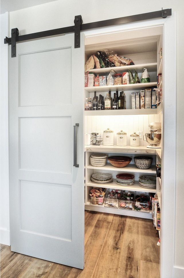 Barn door conceals kitchen pantry.