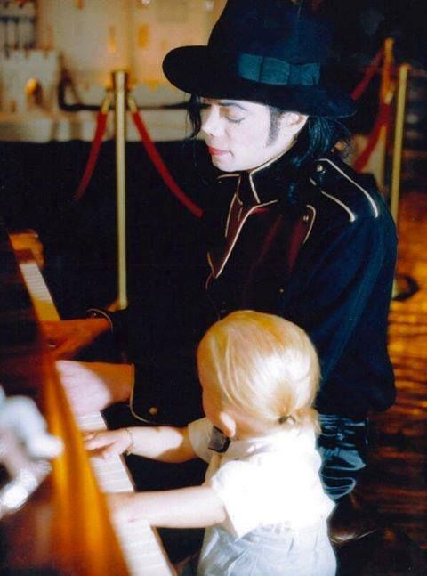 Teaching his son Prince how to play :)