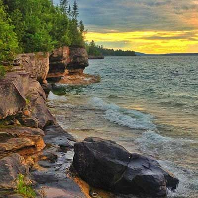 """Winning """"Pure Michigan Moment"""" - of a sunset over Lake Superior near Christmas, MI - will appear in the 2014 Pure Michigan Travel Guide."""