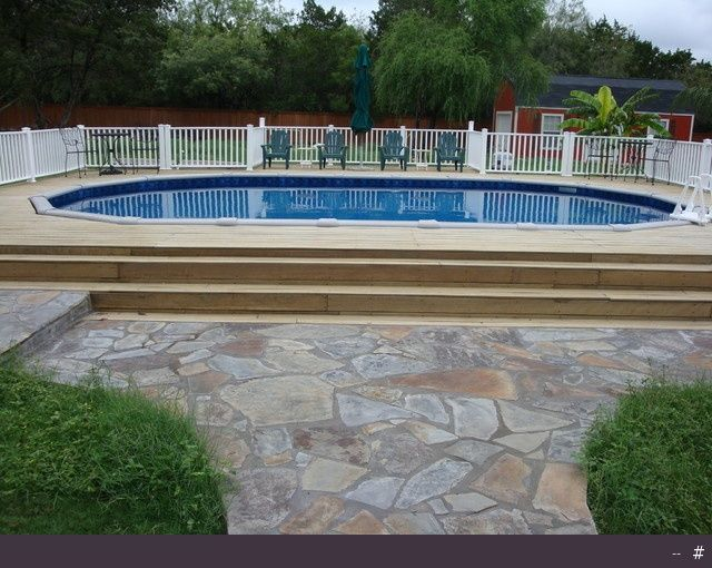 Oval above ground pool with deck - traditional - swimming pools