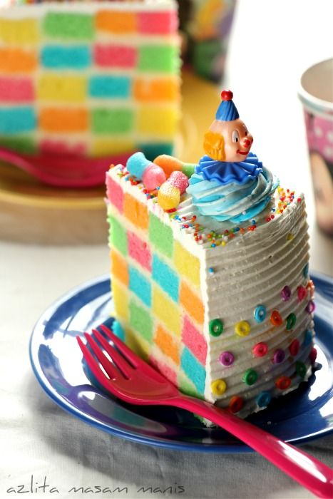 Checkered rainbow birthday cake ~ I've made this with 3 colors, but never with 5... and no clowns...
