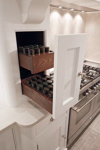 Great kitchen storage idea for herb and spice bottles in side of faux chimney | Dovetail Drawers - Dovetail Joints - Tom Howley | Discover more at www.mycasainteriors.com