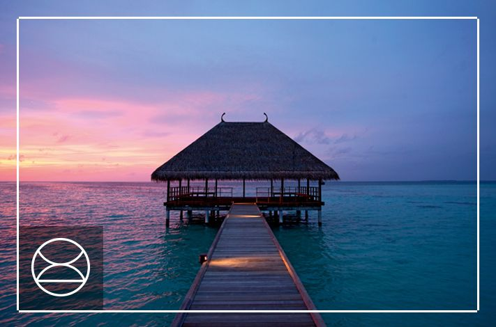 Stunning sunsets create the perfect backdrop to a wedding at Constance Moofushi, Maldives