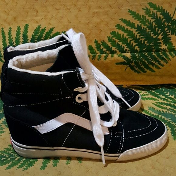 Vans Wedges Shoes Black High Top Womens 8 Vans tennis shoes high tops black with white stripe.  Inner hidden wedge makes you taller without people knowing it's there!  Size 8 women's.  Good condition. Vans Shoes Sneakers