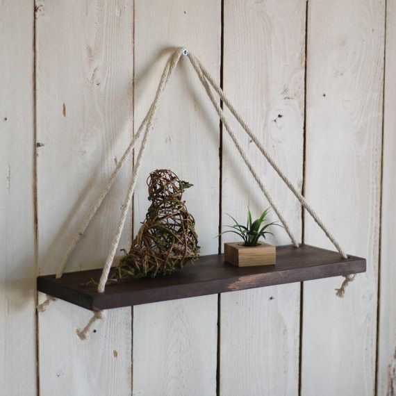 This rustic hanging rope shelf is handcrafted out of solid pine wood. Each piece is built by hand and comes with its own authentic character. *Color in image is Kona* Made in the USA! Shelf measures 1