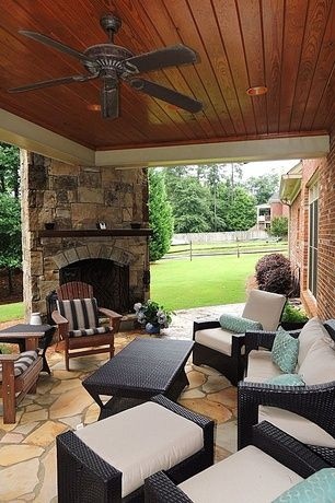 Traditional Porch with specialty window, Wood paneled ceiling, Screened porch, Exterior stone fireplace, Fence