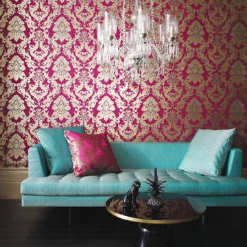 Duck-egg blue sofa in front of pink baroque wallpaper (Matthew Williamson for Osborne  Little, Eden Collection)