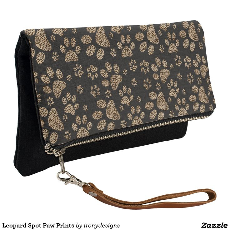 Leopard Spot Paw Prints Clutch Leopard Skin Design made with brown leopard spots inside the big cat paw prints on a black colored background. Elegant wild cat lover and pet lovers design with the leopard pattern print.