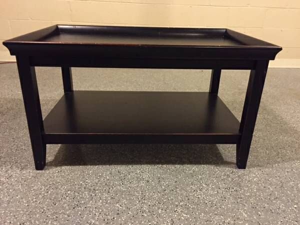 Pier 1 two-tiered distressed black coffee table, distressed marks are a burnt orange/reddish color. Good condition. There are a few water spot damages on the top of the table as show in the 4th...