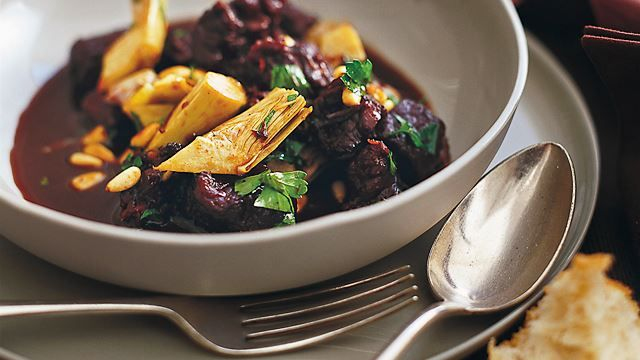 Braised beef with artichokes and pine nuts