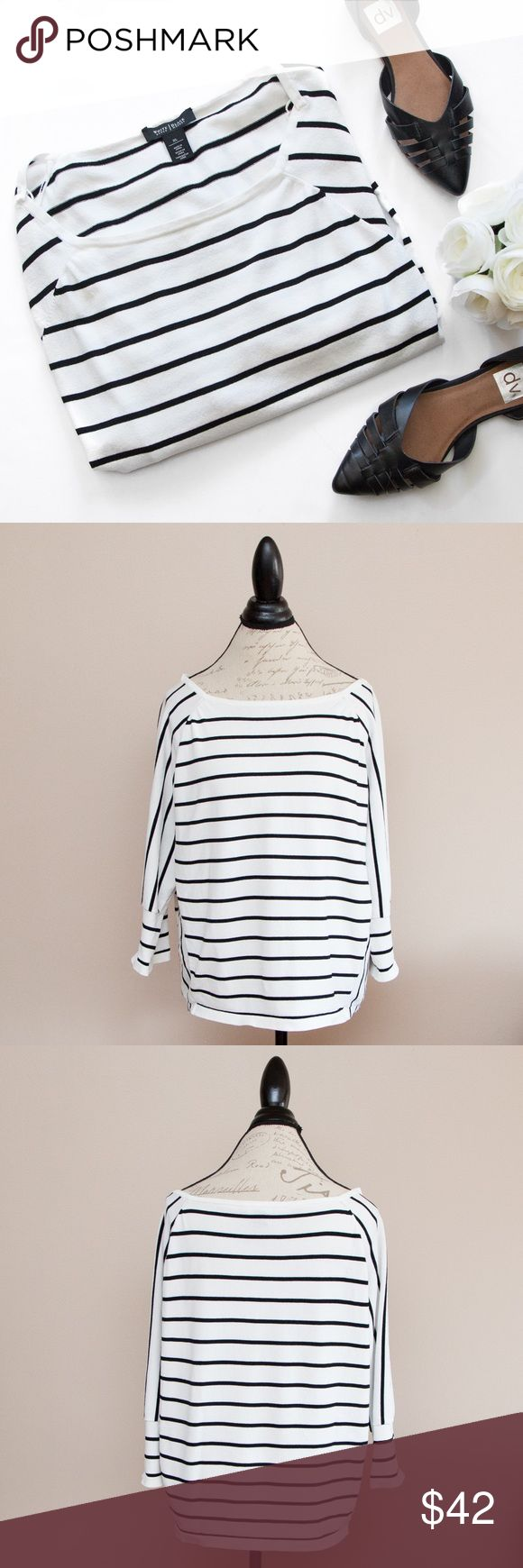 """White House Black Market Striped Dolman Blouse Beautiful White House Black Market blouse perfect for spring and summer! Horizontal and vertical stripes. 3/4 dolman sleeves. 65% nylon, 35% nylon. Measures approx. 23.5"""" armpit to armpit and approx. 23"""" L. Has 2 teeny tiny pulls and there's a little flap on the right shoulder that isn't fully stitched down (see photos); otherwise excellent pre-loved condition!  🚫no trades 🚫no modeling ✅dog friendly/🚭smoke free home ✅reasonable offers ✅bundle…"""